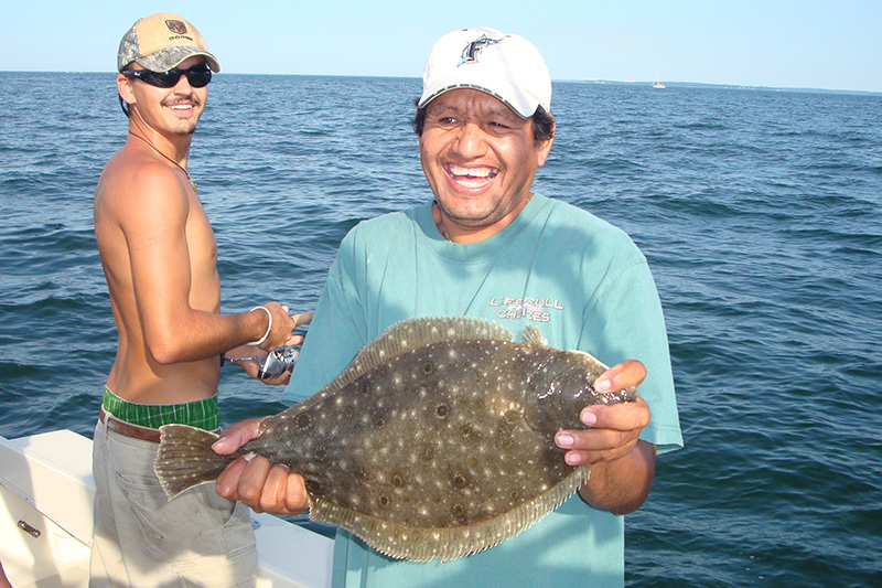 Fishing Charters Flounder Fish Caught by Happy Angler