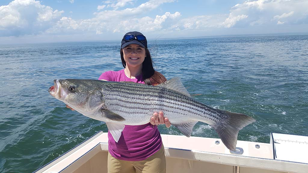 Girl with Striped Bass